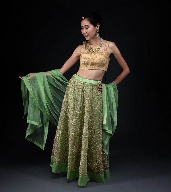 Green Net Embroided Skirt  With Brocade Blouse and Net Dupatta